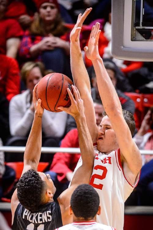 Trent Nelson  |  The Salt Lake Tribune Utah Utes forward Jakob Poeltl (42) defending Stanford Cardinal guard Dorian Pickens (11), as the University of Utah hosts Stanford, NCAA basketball at the Huntsman Center in Salt Lake City, Saturday January 30, 2016.