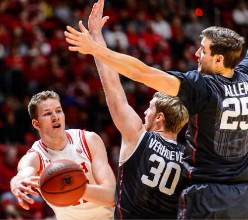 Trent Nelson  |  The Salt Lake Tribune Utah Utes forward Jakob Poeltl (42) passes around Stanford Cardinal center Grant Verhoeven (30) and Stanford Cardinal forward Rosco Allen (25) as the University of Utah hosts Stanford, NCAA basketball at the Huntsman Center in Salt Lake City, Saturday January 30, 2016.