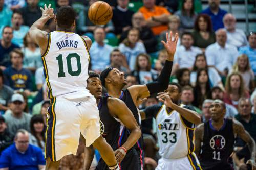 Chris Detrick  |  The Salt Lake Tribune Utah Jazz guard Alec Burks (10) passes to Utah Jazz forward Trevor Booker (33) during the game at Vivint Smart Home Arena Friday April 8, 2016.