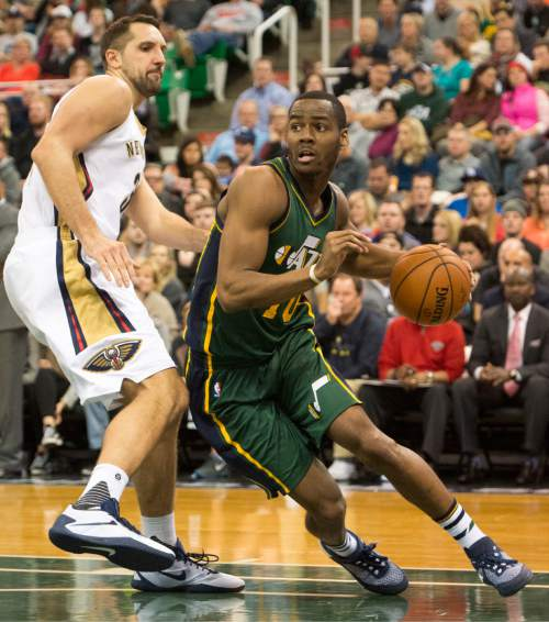 Rick Egan  |  The Salt Lake Tribune  Utah Jazz guard Alec Burks (10) dribbles under the hoop, as New Orleans Pelicans forward Ryan Anderson (33) defends, as the Utah Jazz defeated the New Orleans Pelicans 101-87, in NBA action In Salt Lake City, Saturday, November 24, 2015.