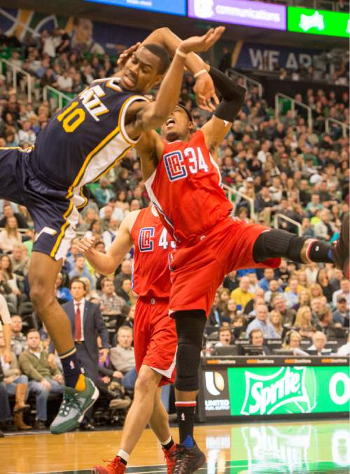 Rick Egan  |  The Salt Lake Tribune  Utah Jazz guard Alec Burks (10) is fouled by Los Angeles Clippers forward Paul Pierce (34), in NBA action, The Utah Jazz vs. The Los Angeles Clippers, in Salt Lake City, Saturday, December 26, 2015.