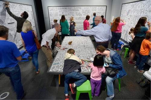 Scott Sommerdorf   |  The Salt Lake Tribune   Visitors to The Leonardo are busy coloring on the panels created by artist Bryan Beach as The Leonardo hosted a Weekend of Welcome, designed to support refugees and the organizations that help them make a successful transition into a new life, Saturday, April 9, 2016.