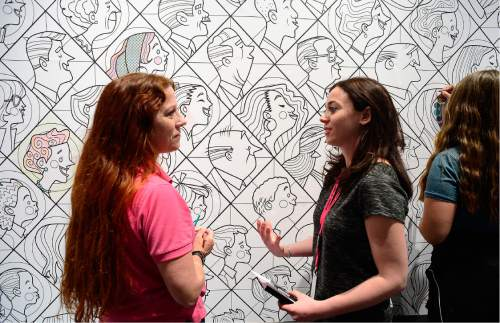 Scott Sommerdorf   |  The Salt Lake Tribune   Marissa Di Simone, right, the Leonardo's exhibit developer speaks with Shanna Futral, left, about one of the exhibits. The Leonardo hosted a Weekend of Welcome, designed to support refugees and the organizations that help them make a successful transition into a new life, Saturday, April 9, 2016.
