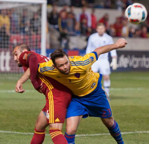 Michael Mangum  |  Special to the Tribune  Colorado Rapids defender Bobby Burling (23) is tied up by Real Salt Lake forward Yura Movsisyan (14) during the second half their match at Rio Tinto Stadium in Sandy, UT on Saturday, April 9, 2016. RSL won 1-0.
