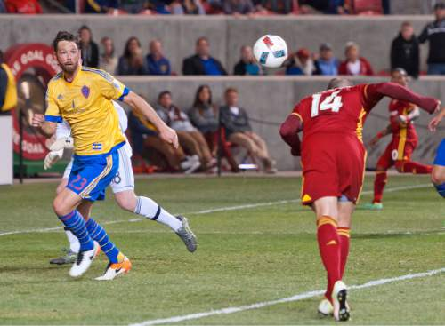 Michael Mangum  |  Special to the Tribune  Real Salt Lake forward Yura Movsisyan (14) heads the ball on frame in front of Colorado Rapids defender Bobby Burling (23) in the dying seconds of the second half their match at Rio Tinto Stadium in Sandy, UT on Saturday, April 9, 2016. RSL won 1-0.