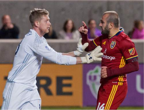 Michael Mangum  |  Special to the Tribune  Real Salt Lake forward Yura Movsisyan (14) scuffles with Colorado Rapids goalkeeper Zac MacMath (18) after MacMath shoved Movsisyan during their match at Rio Tinto Stadium in Sandy, UT on Saturday, April 9, 2016. RSL won 1-0.