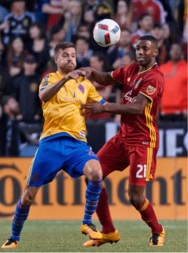 Michael Mangum  |  Special to the Tribune  Colorado Rapids forward Luis Solignac (21) and Real Salt Lake defender Aaron Maund (21) battle for a 50-50 ball during the first half their match at Rio Tinto Stadium in Sandy, UT on Saturday, April 9, 2016.
