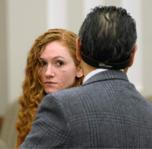 Steve Griffin  |  The Salt Lake Tribune   Jasmine Bridgeman, who pleaded guilty to obstructing justice in the beating death of her 2-year-old son J.J. Sieger, stands with her attorney Ronald Fujino in Judge John R. Morris' courtroom for sentencing at the Davis Justice Center in Farmington, Monday, April 11, 2016.