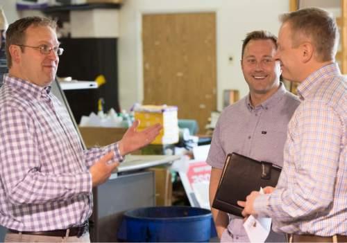 Rick Egan     The Salt Lake Tribune  Shane Lyon of Lyon Printing (left) talks with Taylor Morgan and Democratic congressional candidate Doug Owens at his print shop, Thursday, April 7, 2016.