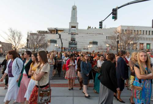 Trent Nelson  |  The Sale Lake Tribune Attendees pour out of the Conference Center following the Church of Jesus Christ of Latter-day Saints' Young Women's conference, Saturday March 30, 2013 in Salt Lake City.