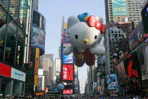 FILE-- In this Nov. 22, 2007 file photo, the Hello Kitty balloon makes its first appearance in the annual Macy's Thanksgiving Day parade as it moves through Times Square in New York.  The first Hello Kitty Con, a four-day festival of all things Kitty held in honor of the character's 40th birthday, opens Oct. 30, 2014, in Los Angeles. (AP Photo/Frank Franklin II, File)