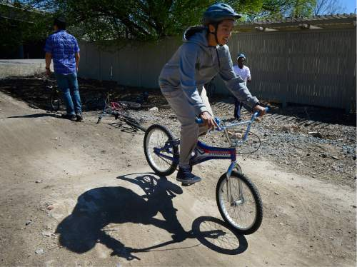 Scott Sommerdorf   |  The Salt Lake Tribune   Students from Glendale Middle School bicycled over to the 9-Line Pump Track and checked put the bike course there,  and offered their ideas for a future public art installation at the site, Thursday, April 7, 2016.