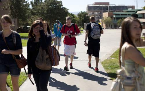 Jud Burkett  |  The Spectrum & Daily News Dixie State College students make their way across campus Wednesday, Oct. 12, 2011 in St. George.