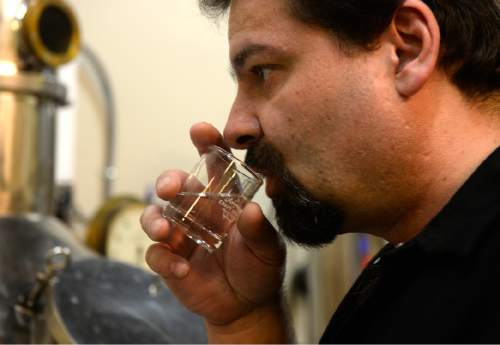 Rick Egan  |  The Salt Lake Tribune  Kirk Sedgwick tests the rum he distills from fancy molasses and his own blend of spices at Outlaw Distillery in Midvale. Wednesday, March 23, 2016.