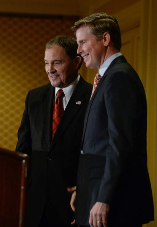 Francisco Kjolseth | The Salt Lake Tribune Republican candidates for Utah governor, Governor Gary Herbert, left, and Jonathan Johnson, pose for photographs following the first fledged debate at the Little America Hotel in Salt Lake City on Monday, April 11, 2016.