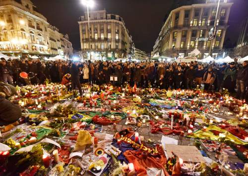 Hundreds of people come together at Place de la Bourse to mourn on Wednesday evening, March 23, 2016. Bombs exploded yesterday at the Brussels airport and one of the city's metro stations, killing and wounding scores of people, as a European capital was again locked down amid heightened security threats. (AP Photo/Martin Meissner)