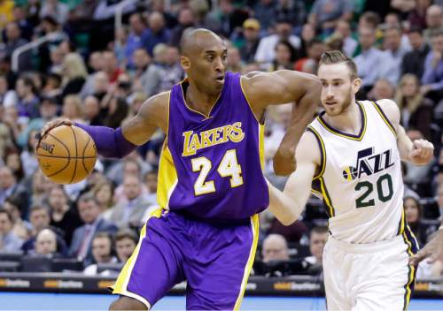 Los Angeles Lakers forward Kobe Bryant (24) drives around Utah Jazz forward Gordon Hayward (20) during the first quarter of an NBA basketball game, Monday, March 28, 2016, in Salt Lake City. (AP Photo/Rick Bowmer)