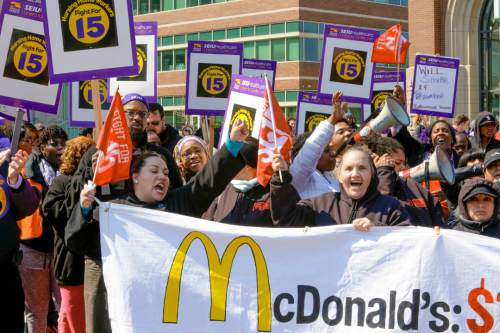 "Nursing home workers and their supporters join ""Fight for $15"" protesters calling for a union and pay of $15 an hour on the campus of Loyola University in Chicago, Thursday, April 14, 2016. The ""Fight for $15"" campaign is part of an ongoing push targeting McDonald's, the world's biggest hamburger chain. (AP Photo/Teresa Crawford)"