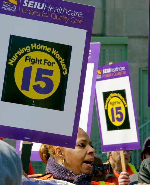 "Nursing home workers and their supporters join ""Fight for $15"" protesters calling for a union and pay of $15 an hour on the campus of Loyola University in Chicago, Thursday, April 14, 2016. The ""Fight for $15"" is part of an ongoing push targeting McDonald's, the world's biggest hamburger chain. (AP Photo/Teresa Crawford)"