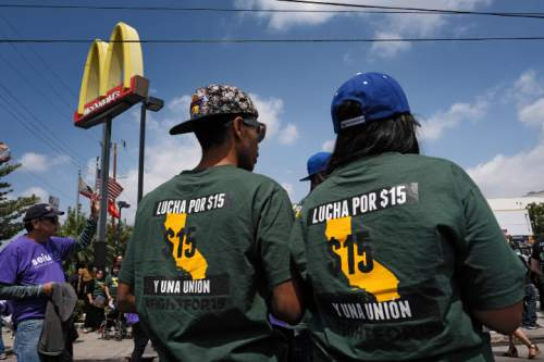 Protesters gather at a McDonald's restaurant in downtown Los Angeles on Thursday, April 14, 2016. Protesters calling for pay of $15 an hour and a union were at McDonald's restaurants around the country and overseas Thursday as part of an ongoing push targeting the world's biggest hamburger chain. (AP Photo/Richard Vogel)