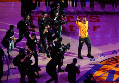 Los Angeles Lakers forward Kobe Bryant waves to the crowd during a ceremony before Bryant's last NBA basketball game, against the Utah Jazz, Wednesday, April 13, 2016, in Los Angeles. (AP Photo/Mark J. Terrill)