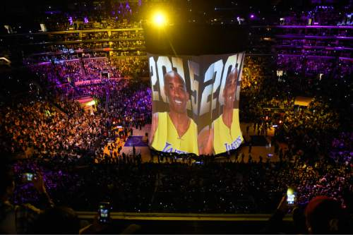 Los Angeles Lakers forward Kobe Bryant image is displayed to the crowd during a ceremony before Bryant's last NBA basketball game, against the Utah Jazz, Wednesday, April 13, 2016, in Los Angeles. (AP Photo/Mark J. Terrill)