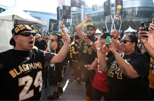 Kobe Bryant fan Fernado Alvarez, left, of Shafter, Calif, leads a cheer outside outside Staples Center fore the Los Angeles Lakers' NBA basketball game against the Utah Jazz, Bryant's last game in the league, Wednesday, April 13, 2016, in Los Angeles. (Ed Crisostomo/The Orange County Register via AP)