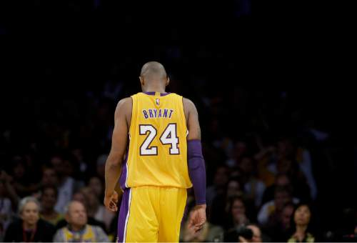 Los Angeles Lakers forward Kobe Bryant walks down the court during the first half of Bryant's last NBA basketball game, against the Utah Jazz, Wednesday, April 13, 2016, in Los Angeles. (AP Photo/Jae C. Hong)
