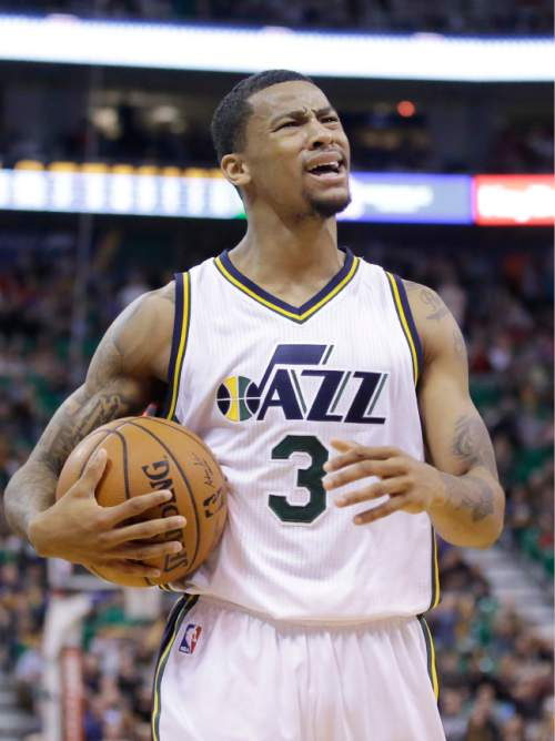 FILE - This Dec. 5, 2015, file photo, Utah Jazz guard Trey Burke (3) reacts to a call in the second half during an NBA basketball game against the Indiana Pacers, in Salt Lake City. The rise of Shelvin Mack has precipitated the fall of Burke in the Utah Jazz lineup, but the former No. 9 overall pick hasn't been an distraction on a team looking to reach the playoffs for the first time since 2012. (AP Photo/Rick Bowmer, File)