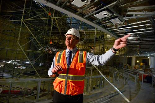 Scott Sommerdorf   |  The Salt Lake Tribune   Steve Swisher, of GTS Development, points out features inside the main seating area of the theater during a tour of the construction on The George S. and Dolores Doré Eccles Theater in downtown Salt Lake City on Thursday, April 14, 2016.