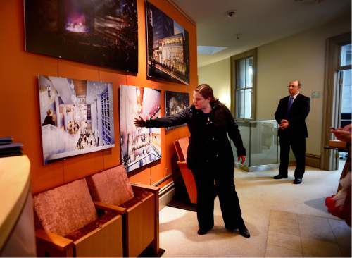 Scott Sommerdorf   |  The Salt Lake Tribune   Katherine Potter, executive director of the Utah Performing Arts Center Agency, points out various features of the George S. and Dolores Doré Eccles Theater on artists renderings prior to a construction tour of the space in downtown Salt Lake City as it stands today, Thursday, April 14, 2016. Steve Swisher of GTS Development is at right.