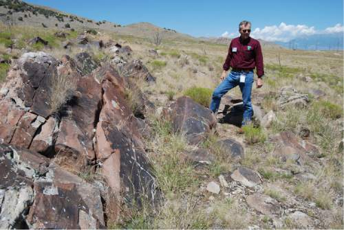 Brian Maffly  |  The Salt Lake Tribune   Mike Sheehan, a BLM archaeologist, describes ancient petroglyphs at Utah's Lake Mountains that have been damaged by gunfire. A draft plan proposes closing this and other lands here totalling 3,450 acres to target shooting.