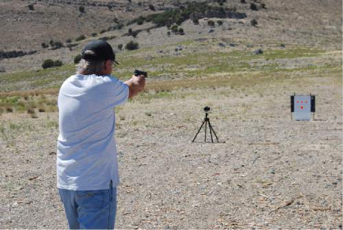 Brian Maffly  |  The Salt Lake Tribune   A man, who identified himself as Tony, takes aim at paper targets with a 9mm handgun on public lands west of Utah Lake. The Bureau of Land Management has initiated a public process to revise a management plan on a 9,000-acre area on the Lake Mountains to help curb impacts associated with target shooting, including dumping, damage to ancient rock art, wildland fire, and threats to public safety. Stray bullets are known to have crossed State Route 68 and to have struck cows and a residence.