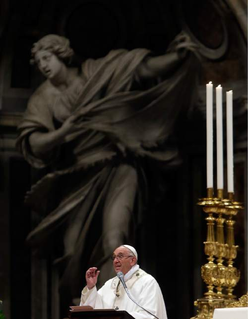 Pope Francis delivers his message as he celebrates an Easter vigil service, in St. Peter's Basilica, at the Vatican, Saturday, March 26, 2016. (AP Photo/Gregorio Borgia)