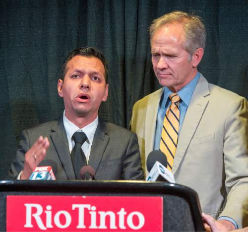 Rick Egan  |  The Salt Lake Tribune Rosemberg Salgado stands next to Ed Smart at an April news conference as he pleads for help in the search for his niece, 26-year-old Elizabeth Elena Laguna-Salgado, who was last seen April 16.