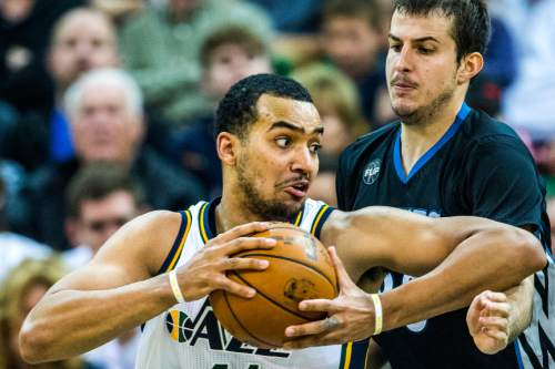 Chris Detrick  |  The Salt Lake Tribune Utah Jazz forward Trey Lyles (41) spins around Minnesota Timberwolves forward Nemanja Bjelica (88) during the game at Vivint Smart Home Arena Friday April 1, 2016. Utah Jazz defeated Minnesota Timberwolves 98-85.