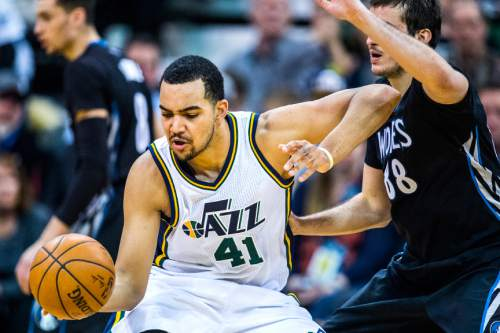 Chris Detrick  |  The Salt Lake Tribune Utah Jazz forward Trey Lyles (41) is guarded by Minnesota Timberwolves forward Nemanja Bjelica (88) during the game at Vivint Smart Home Arena Friday April 1, 2016. Utah Jazz defeated Minnesota Timberwolves 98-85.