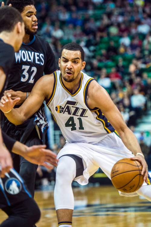 Chris Detrick  |  The Salt Lake Tribune Utah Jazz forward Trey Lyles (41) runs around Minnesota Timberwolves center Karl-Anthony Towns (32) during the game at Vivint Smart Home Arena Friday April 1, 2016.