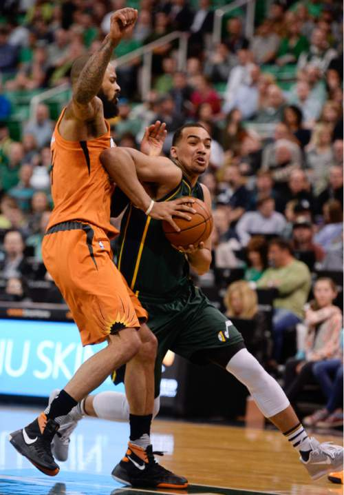 Francisco Kjolseth | The Salt Lake Tribune Phoenix Suns center Tyson Chandler (4) is muscled by Utah Jazz forward Trey Lyles (41) in NBA action, in Salt Lake City, Thursday, March 17, 2016, as the Jazz win 103 to 69.