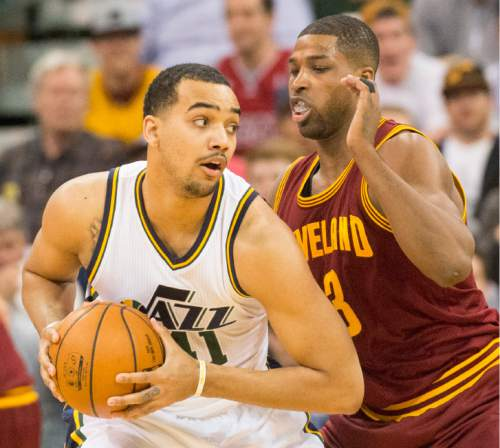 Rick Egan  |  The Salt Lake Tribune  Utah Jazz forward Trey Lyles (41) is guarded by Cleveland Cavaliers center Tristan Thompson (13), in NBA action, in Salt Lake City, Monday March 14, 2016.