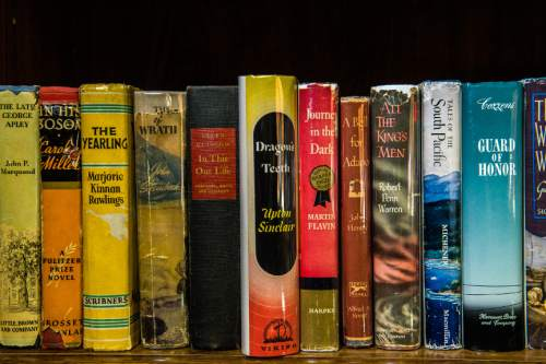 Chris Detrick  |  The Salt Lake Tribune Retired BYU professor Richard Isakson has collected early editions of all 88 Pulitzer Prize-winning novels and displays them in his home in Provo.