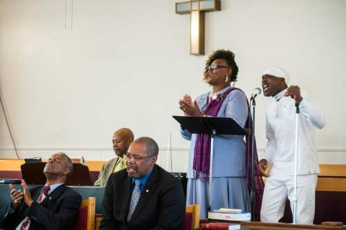Chris Detrick     The Salt Lake Tribune Kevin Nelson and Gwedlyn Minor sing during a pastor appreciation service at Trinity African Methodist Episcopal Church Sunday April 17, 2016. The Rev. Nurjhan Govan has ministered tirelessly for more than a dozen years to members of the Trinity African Methodist Episcopal (AME) Church -- longer than any other pastor at the Salt Lake City landmark.