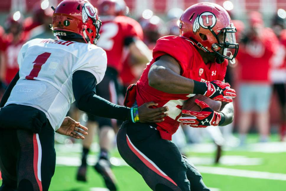 Chris Detrick  |  The Salt Lake Tribune Utah Utes quarterback Tyler Huntley (1) hands off the ball to Utah Utes running back Marcel Manalo (27) during the spring scrimmage at Rice-Eccles Stadium Saturday April 9, 2016.