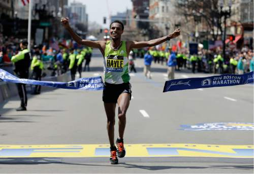 Lemi Berhanu Hayle, of Ethiopia, breaks the tape to win the 120th Boston Marathon on Monday, April 18, 2016, in Boston. (AP Photo/Elise Amendola)