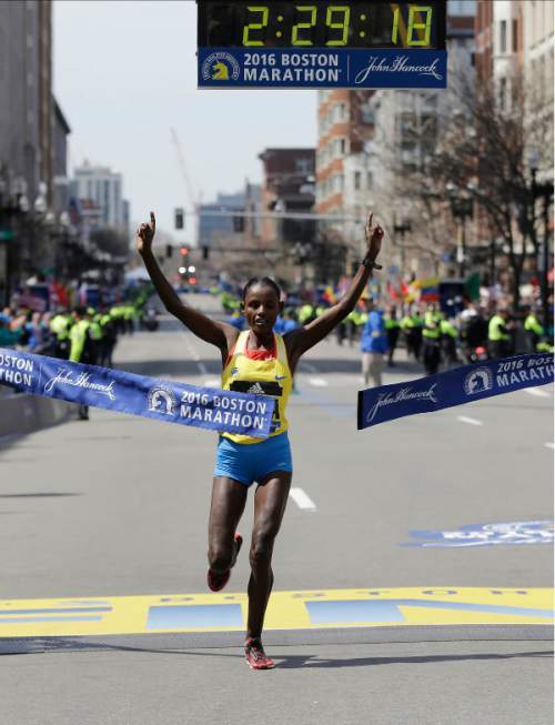 Atsede Baysa, of Ethiopia, breaks the tape to win the women's division of the 120th Boston Marathon on Monday, April 18, 2016, in Boston. (AP Photo/Elise Amendola)