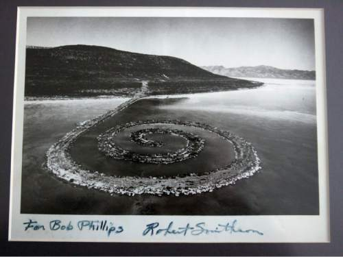 Steve Griffin  |  The Salt Lake Tribune   Artist Robert Smithson gave Bob Phillips this signed photograph of the Spiral Jetty.  Phillips was the contractor who built the Spiral Jetty for Smithson. Phillips died April 11, from cancer. He was 75.