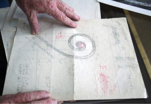 Steve Griffin  |  The Salt Lake Tribune In this 2011 file photo, Bob Phillips looks over photos and original designs for the Spiral Jetty.  Phillips was the contractor who built the Spiral Jetty for artist Robert Smithson.