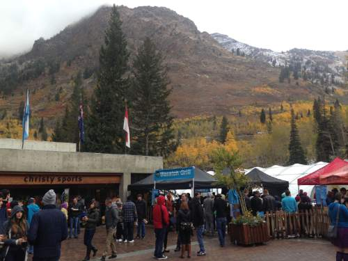 Rick Egan  |  Tribune file photo Crowds brave the cold weather as they drink beer on the Snowbird Plaza, on the last day of the nine-week Oktoberfest celebration at Snowbird in October  2014.