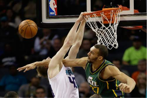 Charlotte Hornets' Cody Zeller (40) gets his dunk attempt and head blocked by Utah Jazz's Rudy Gobert (27) during the first half of an NBA basketball game Monday, Jan. 18, 2016, in Charlotte, N.C. (AP Photo/Bob Leverone)