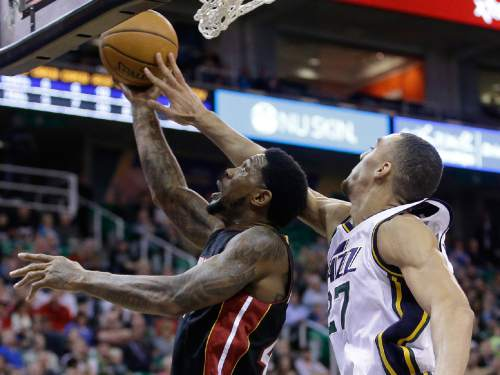Utah Jazz center Rudy Gobert (27) defends against Miami Heat forward Udonis Haslem, left, in the second quarter during an NBA basketball game Friday, Dec. 12, 2014, in Salt Lake City. (AP Photo/Rick Bowmer)